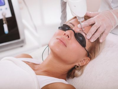 Beautiful mature woman getting facial cosmetology treatment